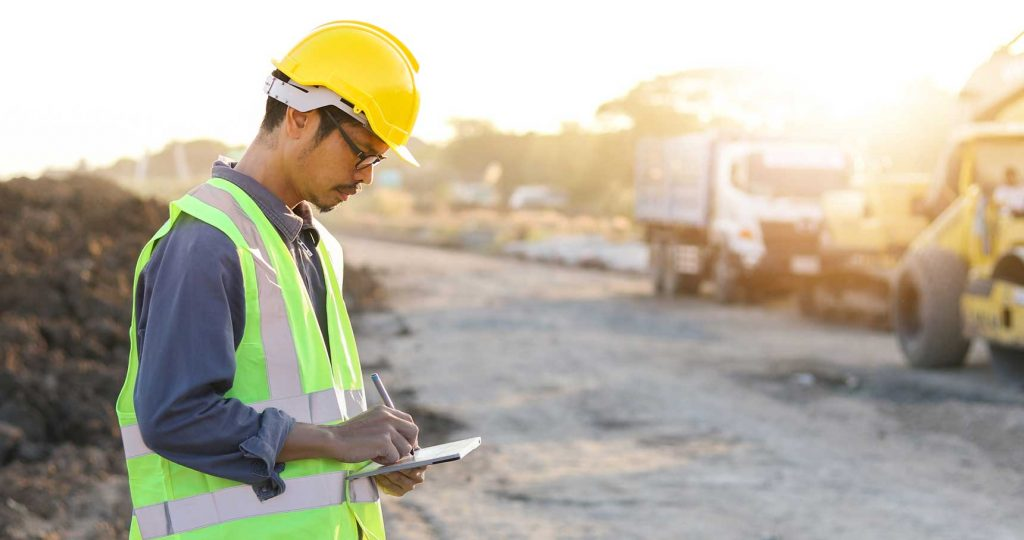Construction Engineer Wrighting On Notepad